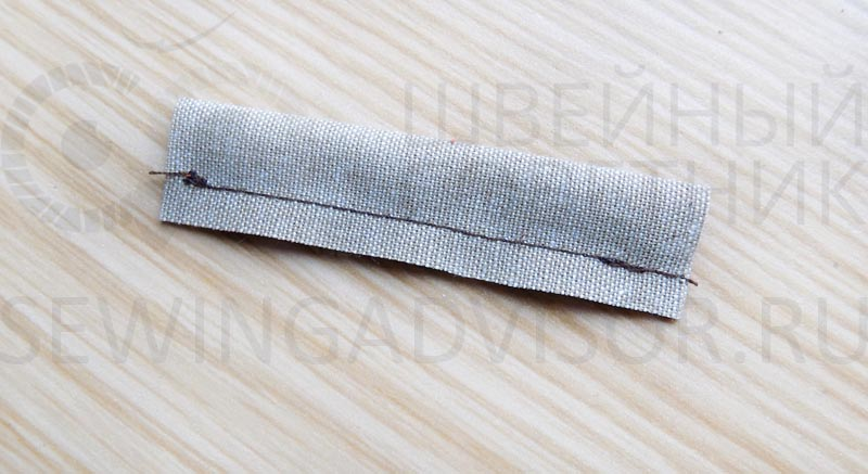 Сложите полоску ткани