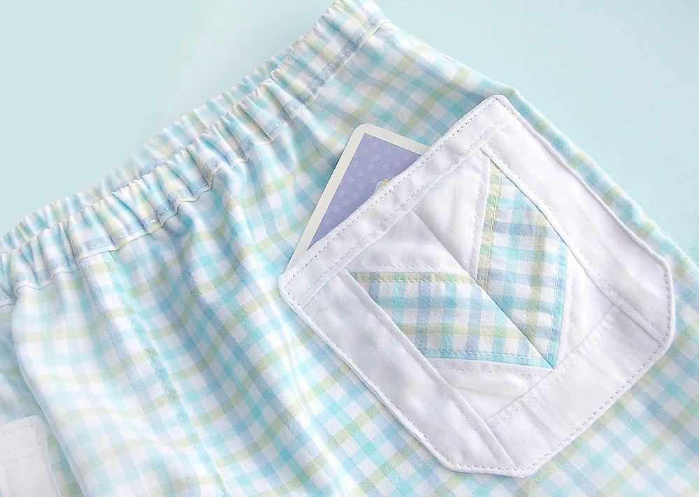 Детские шорты с накладными карманами в стиле «пэчворк»